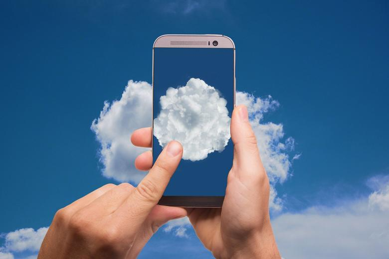 a mobile with a photo of a cloud