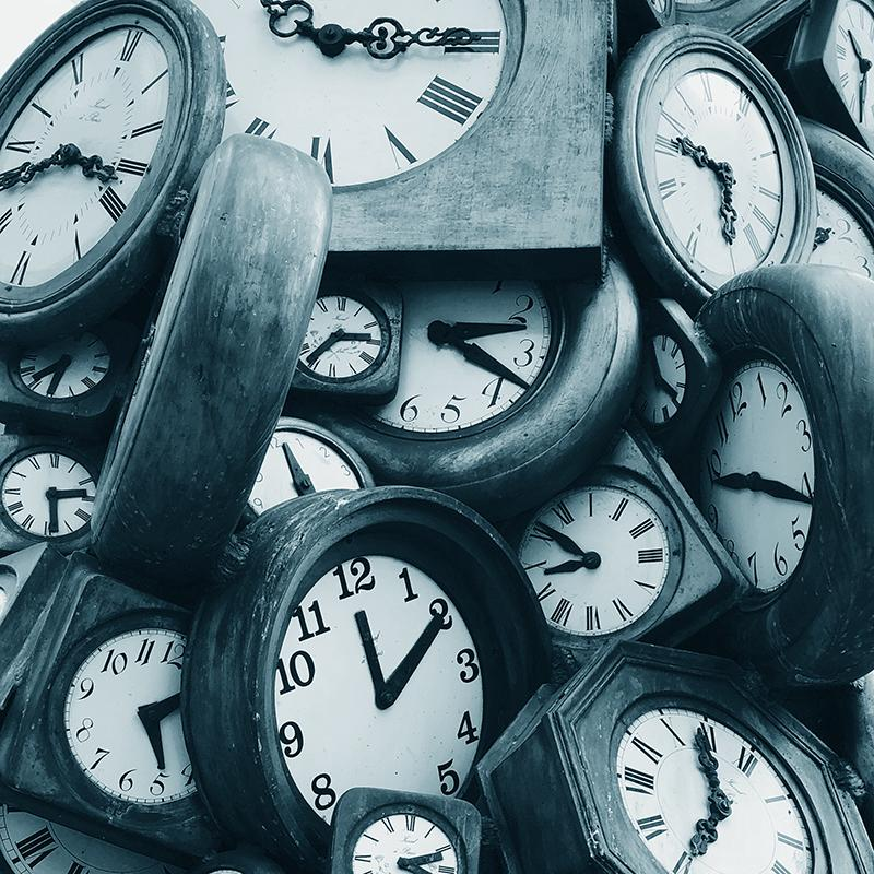 an image of clocks piled on top of each other